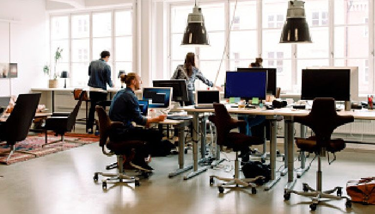 Image of people in an office working at desks